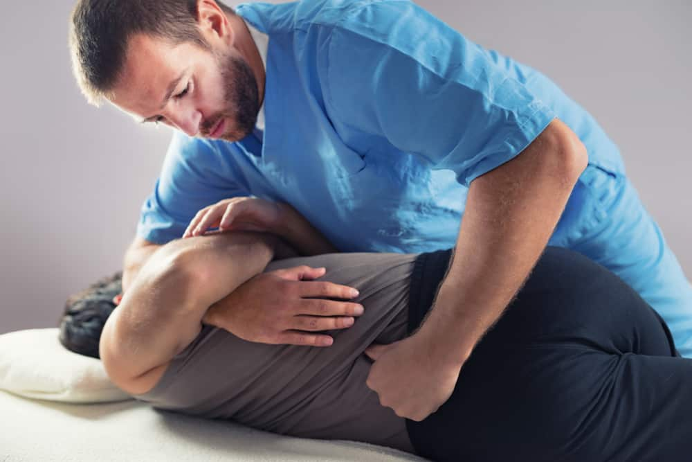 chiropractic-adjusting-male-patient