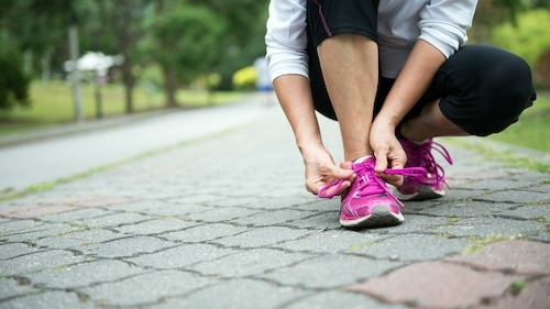 How should running shoes fit when you wear orthotics