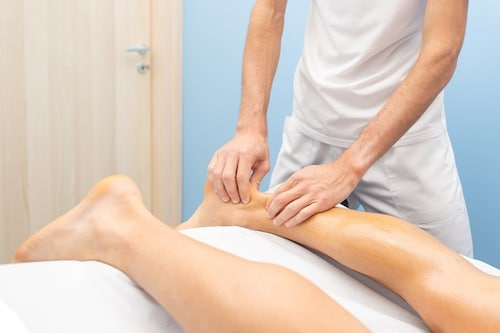 chiropractor during an Achilles tendonitis treatment