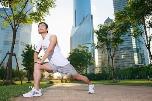 man-stretching-in-city-park