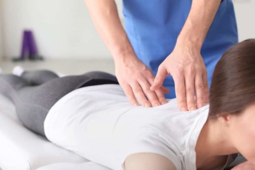 chiropractor-working-female-patient-clinic