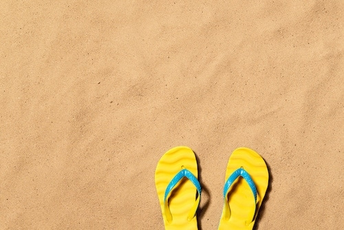 Summer vacation background with a pair of flip flop sandals.