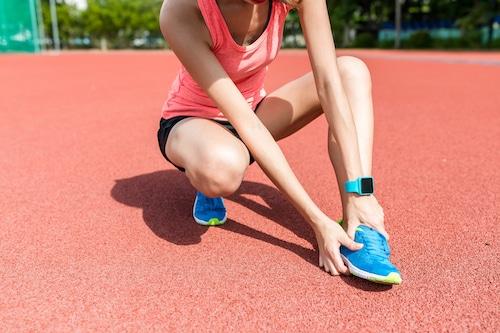 Sport Woman get just on feet sole