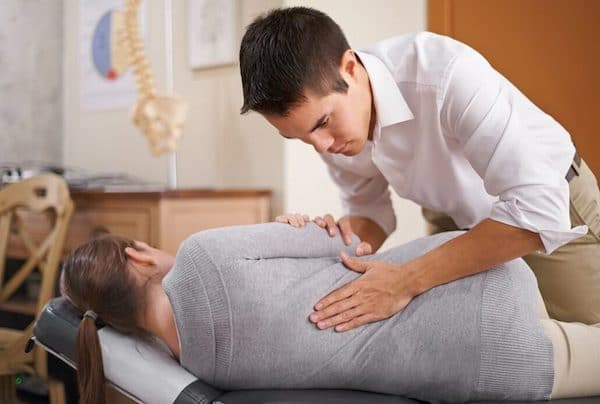 chiropractor-helping-woman-with-hip-pain