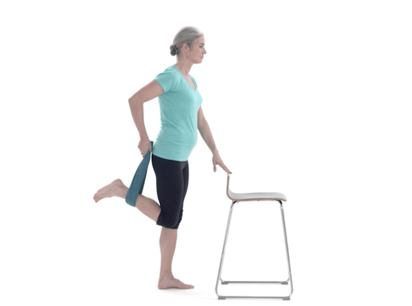 female-quad-stretch-with-towel