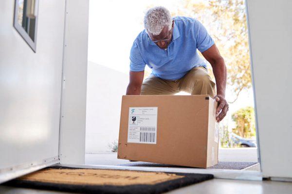 senior-man-gets-back-spasm-while-lifting-box