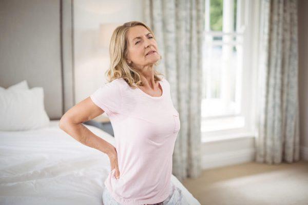 senior-woman-having-back-spasm-pain-in-bedroom