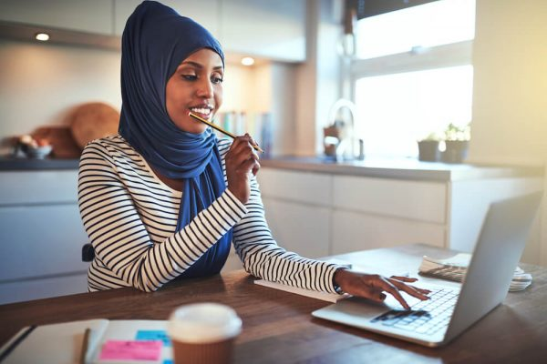 young-arabic-female-entrepreneur-working-from-home-with-good-posture-to-prevent-back-spasm